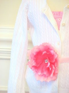 Peony as a belt on white cardi, via Charlotte English Boutique