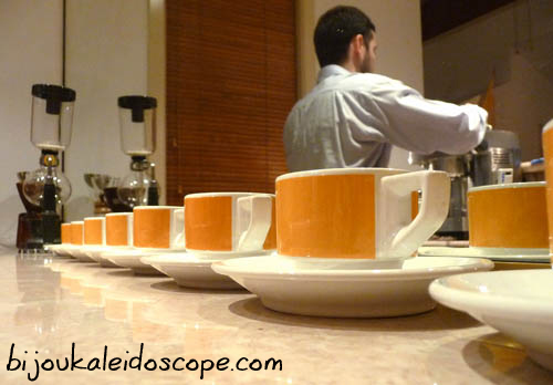 My vintage ACP coffee cups with Andrew making espresso in the background