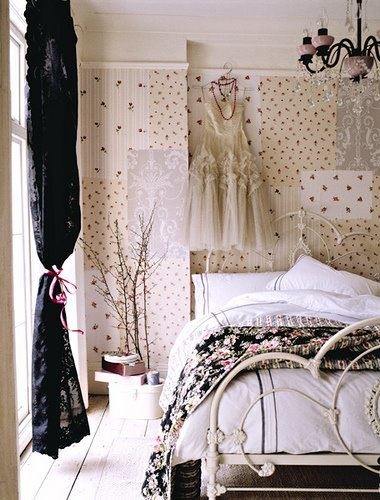 Feminine frilly sheer dress on busy wallpapered bedroom, via Polly Wreford