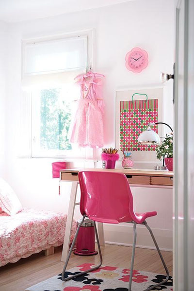 Pretty pink frock in pink and white girl's bedroom