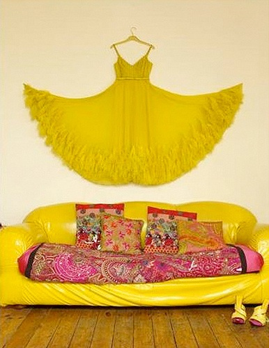 Yellow dress hung on wall, via Selina Lake
