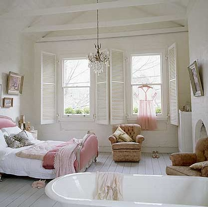 Sheer pink against bright window in white bedroom