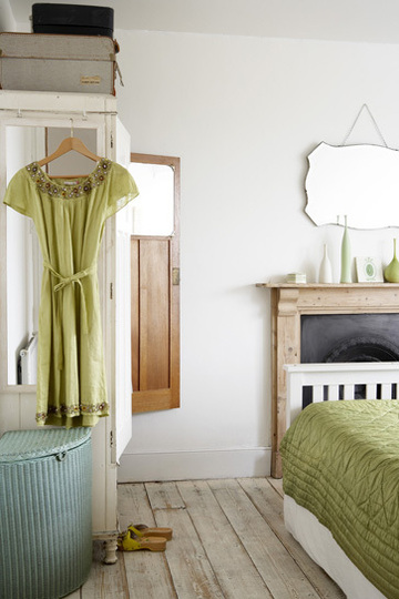 Green dress hanging from a wardrobe, via Rachel Whiting