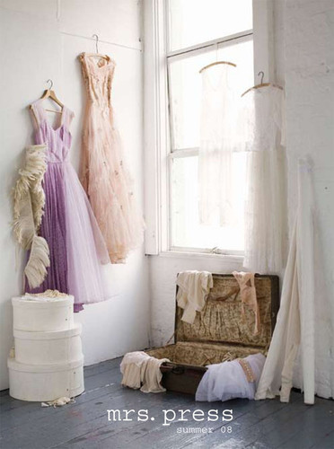 Pale peach and mauve dresses on a wall