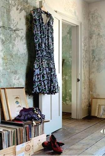 Black dress in pale wallpapered room
