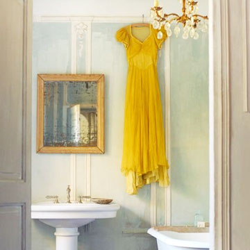Bold long yellow gown in bathroom