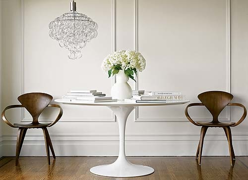 Retro chairs flanking Panton white table