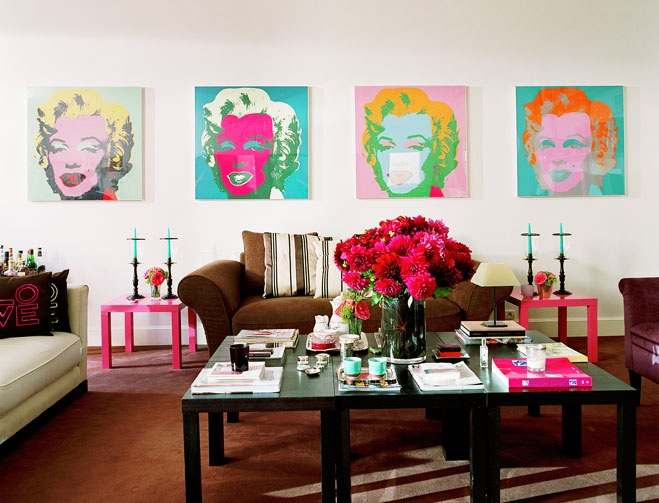 White room with Andy Warhol-esque art and colourful accents