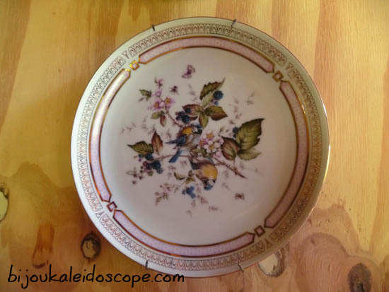 A cute Japanese made plate with pretty bluebirds and cherry blossoms