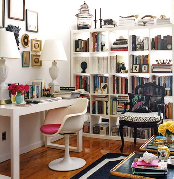 Books and things with white office, white desk and white bookshelves