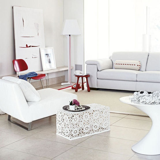 White bright airy living room red accented items via Living Etc