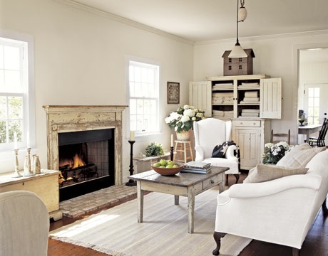 White living room with dollhouse storage solution