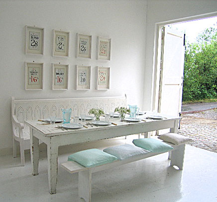 White on white dining room and setting with pale blue accents
