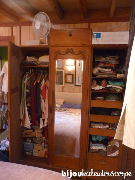 The awful antique wardrobe to store two adults and 1 child.