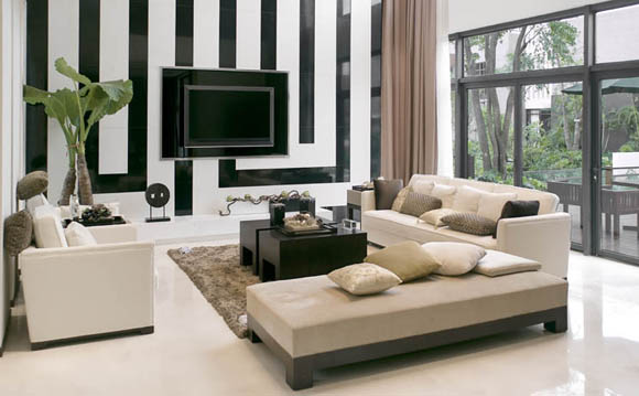 Black and white stripes in this living room make a great feature wall