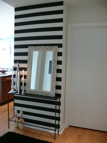 Foyer strikingly wallpapered black and white stripes