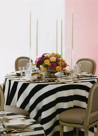Black and white tablecloth set off a dining room