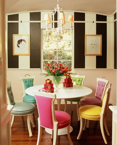 Black and white stripes in a small dining space with candy coloured dining chairs add a touch of irreverent fun and gaiety, via Ruthie Sommers