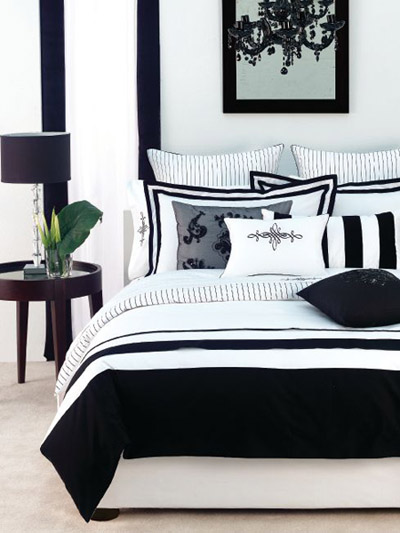 Strong monochromatic scheme in bedroom with black and white stripes, via House of Fraser