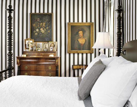 BLack and white tripes grounded by antique pieces in a bedroom in About.com
