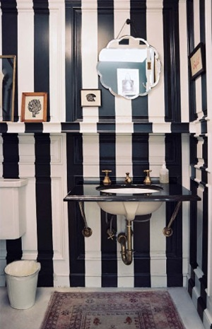 BLack and white dominates this toilet space, via Lonny Mag