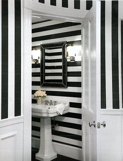 In this spartan bathroom, the black and white stripes from outside is continued inside in opposite direction, via Weena and Spook