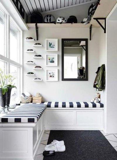 BLack and white striped upholstery adds a modern edge to this corner, via Skona Hem