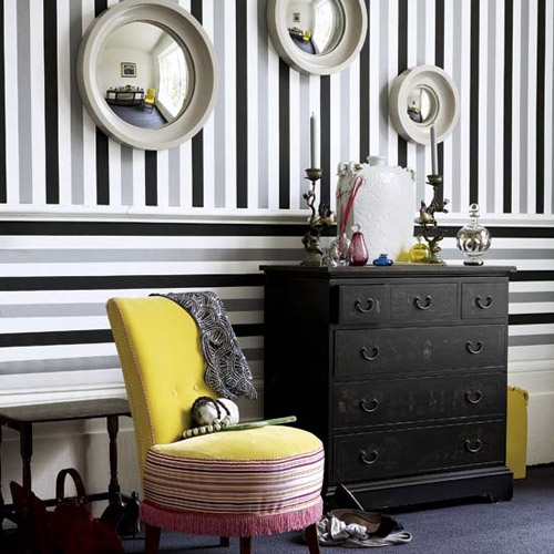 A touch of grey in the midst of white and black stripes soften this corner of the house