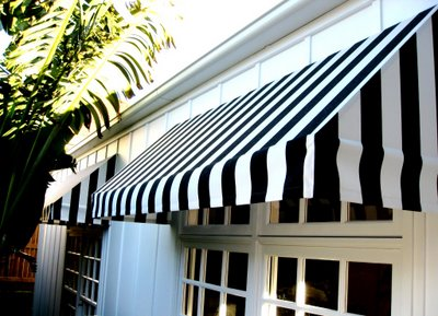 Anna Spiro's black and white striped awning, via Absolutely Beautiful Things
