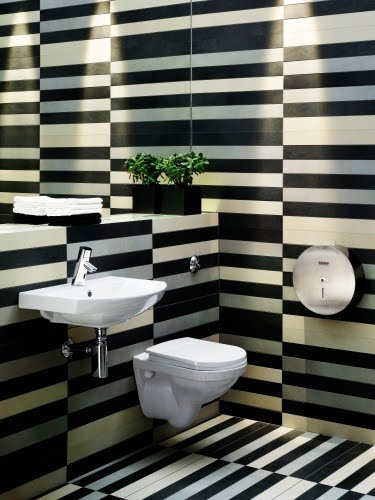 Black and white striped madness in this small toilet