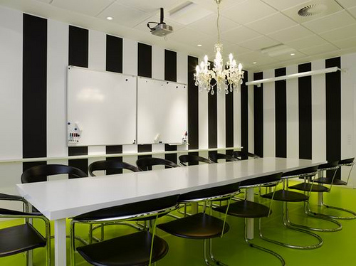 BLack and white stripes contrast with the lime green floor in this office meeting room, via Jordan Guide Design
