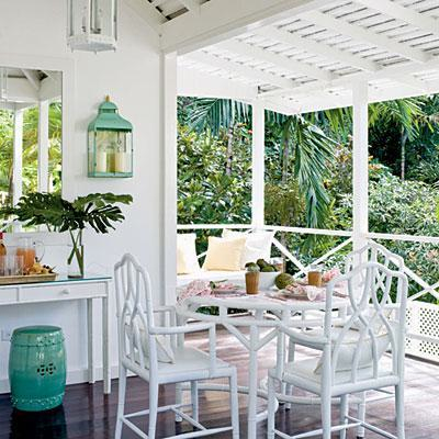 White Chinese Chippendale chairs in an all white porch