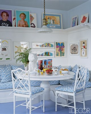 White Chinese Chippendale chairs surround a white table and banquette to create a sunny cheerful and bright nook, via Elle Decor