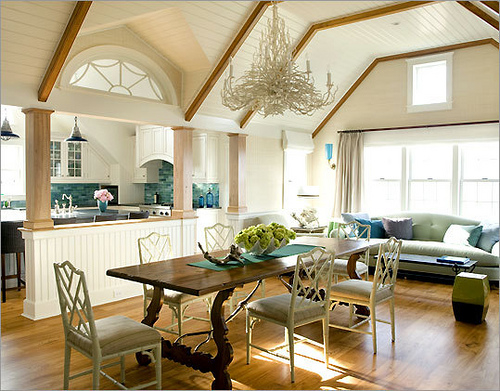 Chinese Chippendale chairs add angular interest to this vaulted ceilinged dining room, via Mudrick