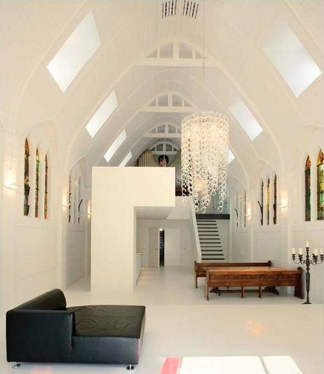 Dining space in all white converted  church