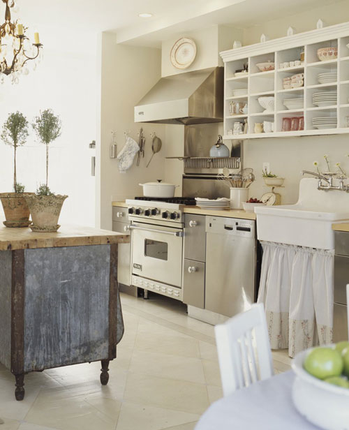 Bright kitchen with open shelving and uber stove