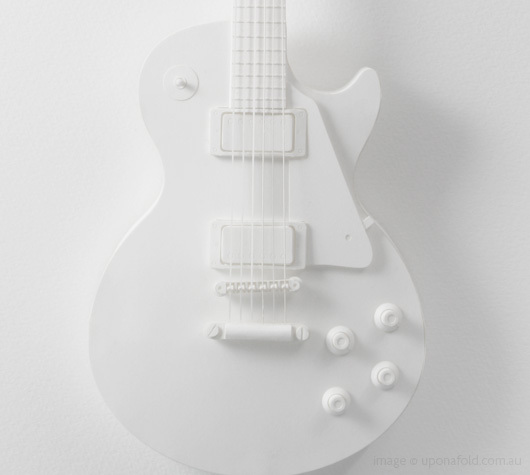 Exquisite guitar folding model kit, via Once Upon a Fold