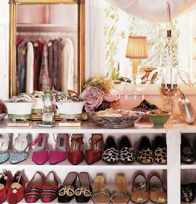 Pretty shoe shelving with chandelier