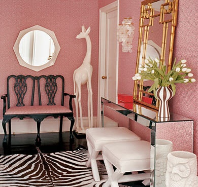 Pink foyer with large gilt mirror, via Lonny Mag