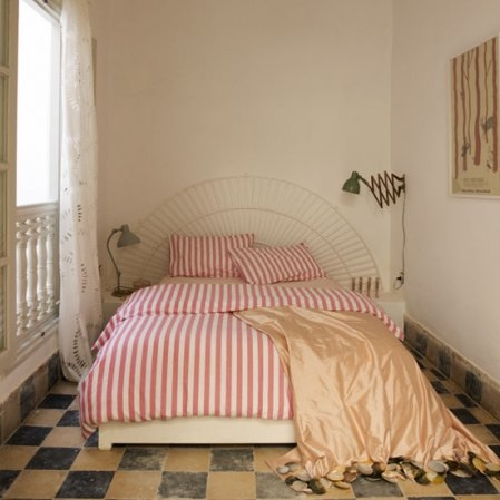 Cane bed with red and white stripes