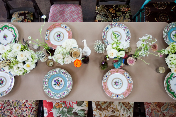 plate setting of pink, blue and green plates via style me pretty