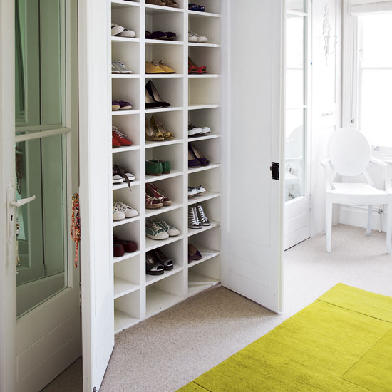 White shelving in a white cupboard, via House to Home