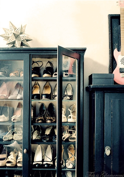 Black glassed bookcase for shoe storage