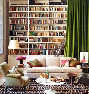 Bookshelves hidden behind green curtain
