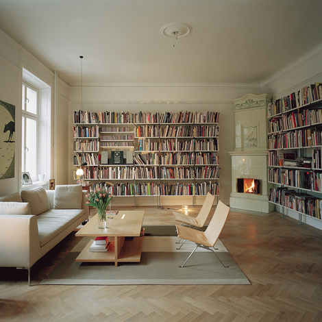 Two walls in a beautful bookshelves