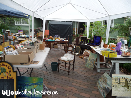 Inside the white tent of 50s garage sale