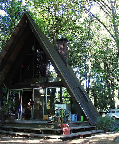A-frame house with black walls and roofs
