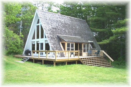 An a-frame house with entrance at the side