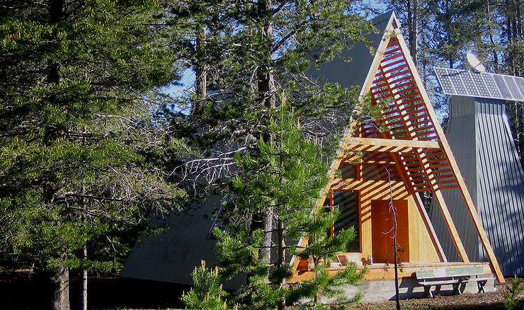 Slatted roof allows light in the front porch of this gorgeous A-frame house, via Chic Nomad A-Frame home in Sierra National Forest, California