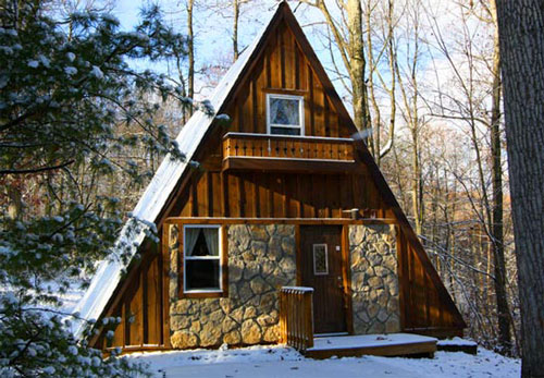 Wood and stone a-frame house